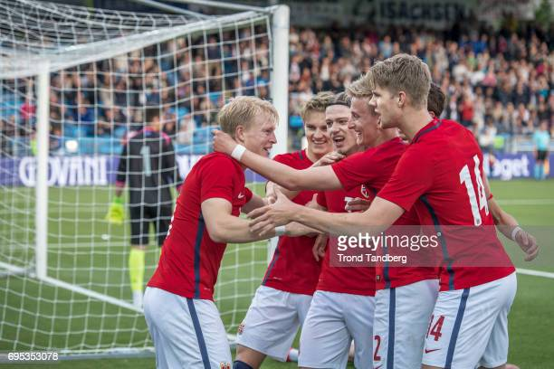 Andreas HancheOlsen celebrate goals with Martin Odegaard Julian Ryerson Erlend Reitan Kristoffer Ajer of Norway during the Qualifying Round European...