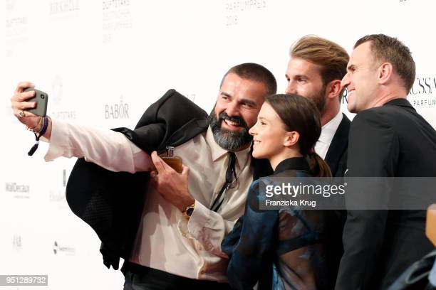 Andreas Haumesser Andre Hamann Aylin Tezel and Jens Ciliax attend the Duftstars at Flughafen Tempelhof on April 25 2018 in Berlin Germany