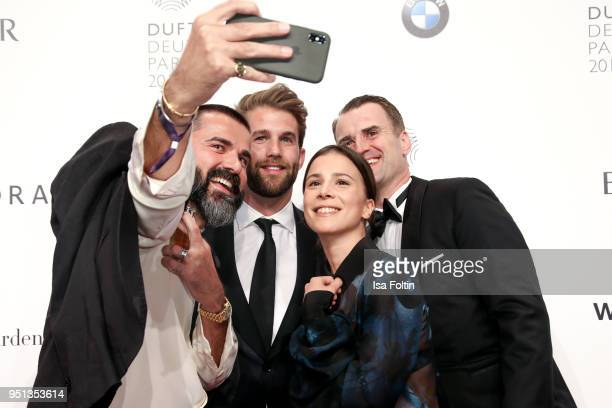Andreas Haumesser model Andre Hamann German actress Aylin Tezel and Jens Ciliax during the Duftstars at Flughafen Tempelhof on April 25 2018 in...