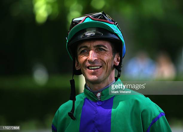 Andreas Helfenbein looks on in the parade ring prior to riding Frantic Storm during the Lotto Festival 2013 at Galopp Munich on June 9 2013 in Munich...