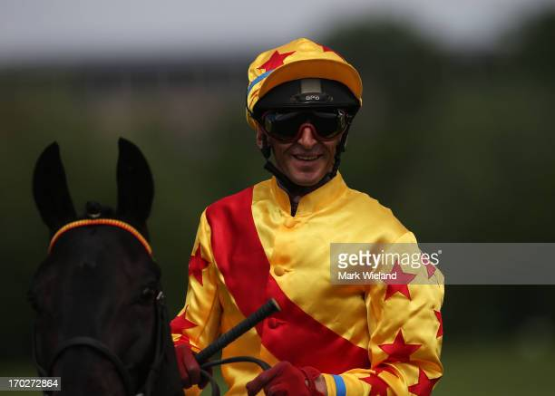 Andreas Helfenbein riding Winkali prepares to race during the Lotto Festival 2013 at Galopp Munich on June 9 2013 in Munich Germany