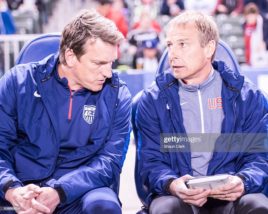 Andreas Herzog confers with head coach Jurgen Klinsmann of the United States during the International Soccer Friendly match between the United States and Canada at the StubHub Center on February 5, 2016 in Carson, California. The United States won the match 1-0