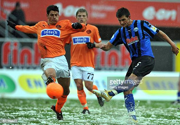 Andreas Hofmann and Andreas Mayer of Aalen against Enis Alushi of Paderborn during the 3 Bundesliga match between SC Paderborn and Vfr Aalen at the...