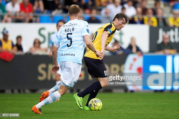 Andreas Holm of FC Helsingor and Pal Alexander Kirkevold of Hobro IK compete for the ball during the Danish Alka Superliga match between Hobro IK and...