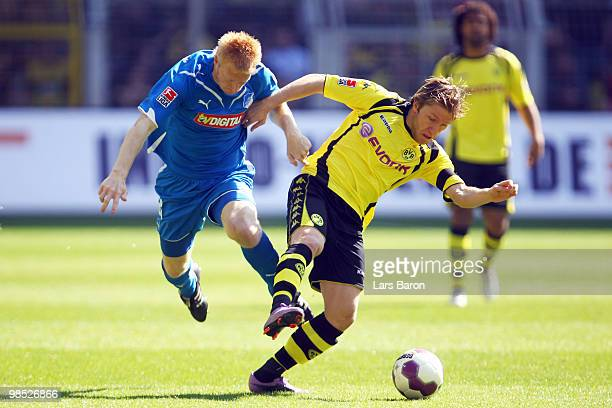 Andreas Ibertsberger of Hoffenheim challenges Jakub Blaszczykowski of Dortmund during the Bundesliga match between Borussia Dortmund and 1899...