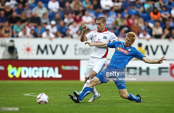 Andreas Ibertsberger of Hoffenheim fights for the ball with Mladen Petric of Hamburg during the Bundesliga match between TSG 1899 Hoffenheim and...
