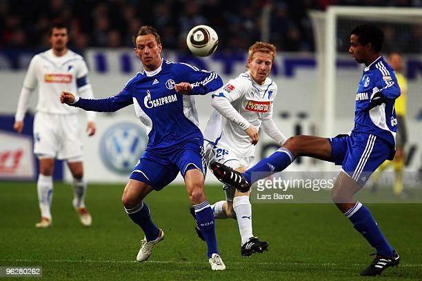 Andreas Ibertsberger of Hoffenheim is challenged by Ivan Rakitic and Joel Matip of Schalke during the Bundesliga match between FC Schalke 04 and 1899...