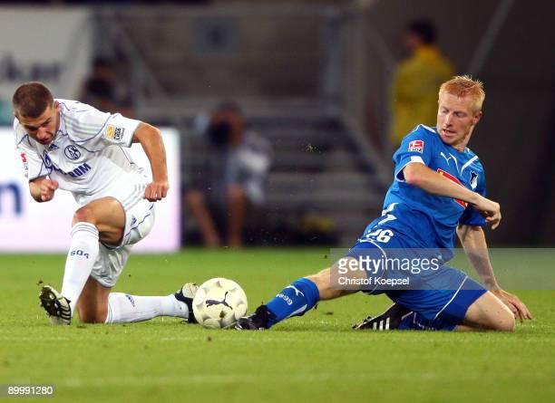 Andreas Ibertsberger of Hoffenheim tackles Levan Kenia of Schalke during the Bundesliga match between 1899 Hoffenheim and FC Schalke 04 at...