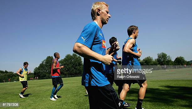 Andreas Ibertsberger of TSG 1899 Hoffenheim and his teammates attend a training session at their training camp on July 2, 2008 in Stahlhofen near...