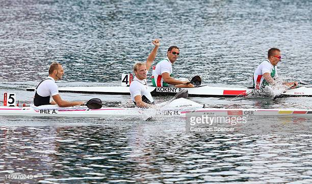 Andreas Ihle and Martin Hollstein of Germany celebrate after winning Bronze in the Men's Kayak Double 1000m Canoe Sprint final on Day 12 of the...