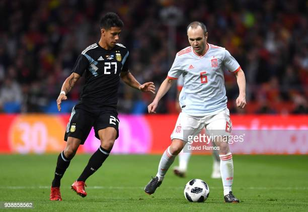 Andreas Iniesta of Spain is challenged by Maximiliano Meza of Argentina during the International Friendly between Spain and Argentina on March 27...