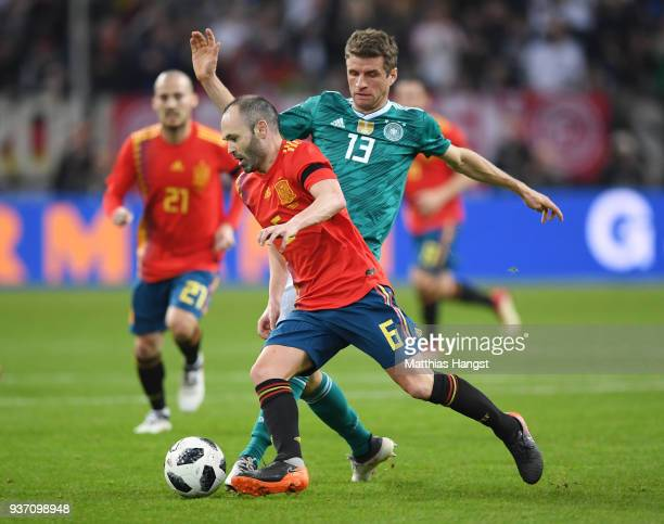 Andreas Iniesta of Spain is challenged by Thomas Mueller of Germany during the International friendly match between Germany and Spain at EspritArena...