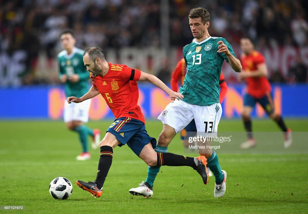 andreas-iniesta-of-spain-is-challenged-b