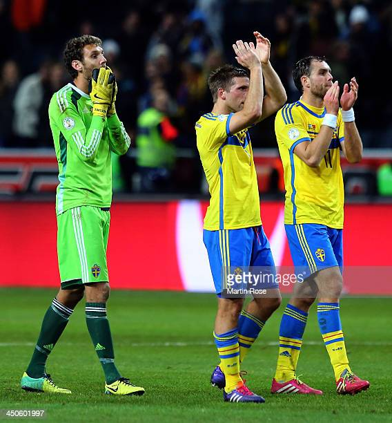Andreas Isaksson Anders Svensson and Johan Elmander of Sweden look dejected after losing the FIFA 2014 World Cup Qualifier Playoff Second Leg match...