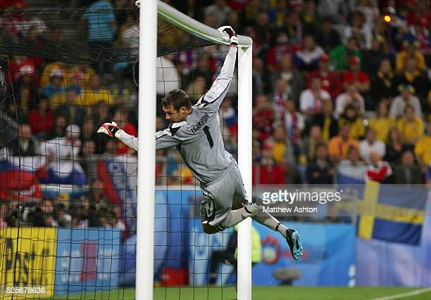 Andreas Isaksson of Sweden hangs from the crossbar during the EURO 2008 preliminary round group D soccer match between Russia and Sweden at the...