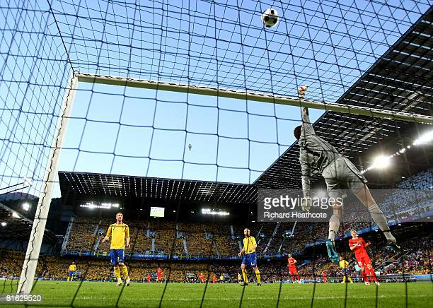 Andreas Isaksson of Sweden tips the ball over the crossbar during the UEFA EURO 2008 Group D match between Russia and Sweden at Stadion Tivoli Neu on...