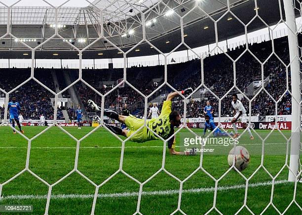 Andreas Ivanschitz of FSV Mainz 05 scores the first goal against Tom Starke of 1899 Hoffenheim during the Bundesliga match between 1899 Hoffenheim...