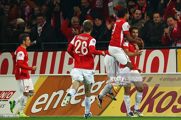 Andreas Ivanschitz of Mainz celebrates his team's first goal with team mates Sami Allagui Niko Bungert and Nicolai Mueller during the Bundesliga...