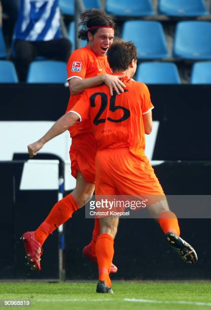 Andreas Ivanschitz of Mainz celebrates the first goal with Tim Hoogland during the Bundesliga match between VfL Bochum and FSV Mainz at Rewirpower...