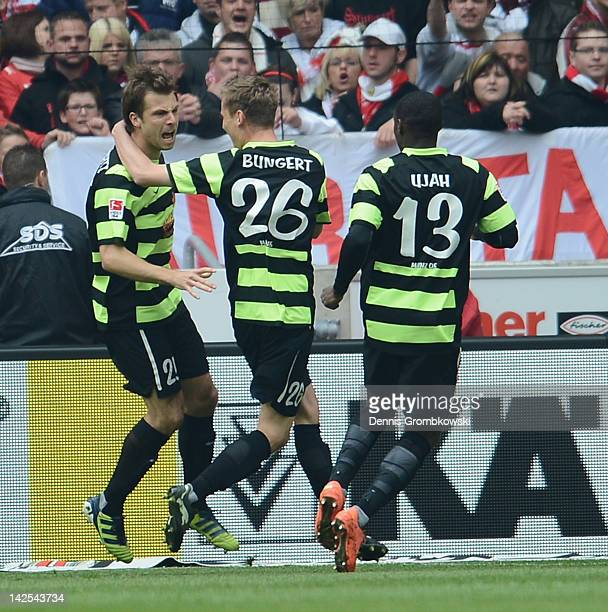 Andreas Ivanschitz of Mainz celebrates with teammates after scoring his team's opening goal during the Bundesliga match between VfB Stuttgart and FSV...