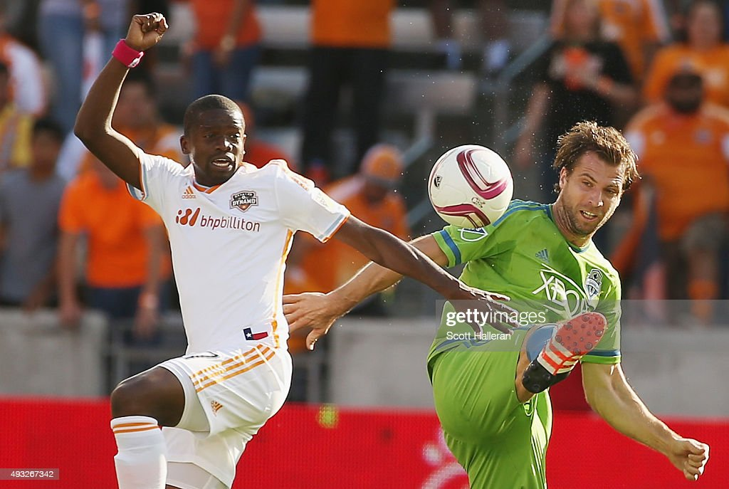 Andreas Ivanschitz #23 of the Seattle Sounders FC and Boniek Garcia #27 of the Houston Dynamo battle for the ball in the first half of their game at BBVA Compass Stadium on October 18, 2015 in Houston, Texas.