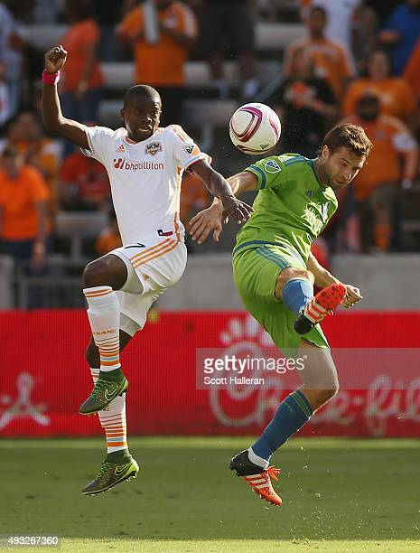 Andreas Ivanschitz of the Seattle Sounders FC and Boniek Garcia of the Houston Dynamo battle for the ball in the first half of their game at BBVA...