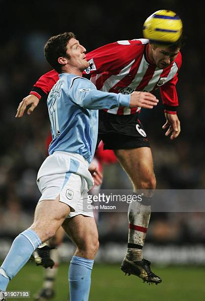 Andreas Jakobsson of Southampton is challenged by Jon Macken of Manchester City during the Barclays Premiership match between Manchester City and...