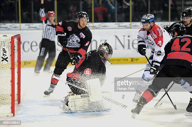 Andreas Jenike of the Thomas Sabo Ice Tigers Nuernberg and Darin Olver of the Eisbaeren Berlin duel during the game between Thomas Sabo Ice Tigers...