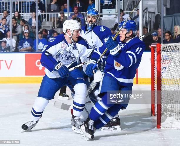 Andreas Johansson of the Toronto Marlies fights for crease space with Slater Koekkoek snd goalie Mike McKenna of the Syracuse Crunch during game 6...