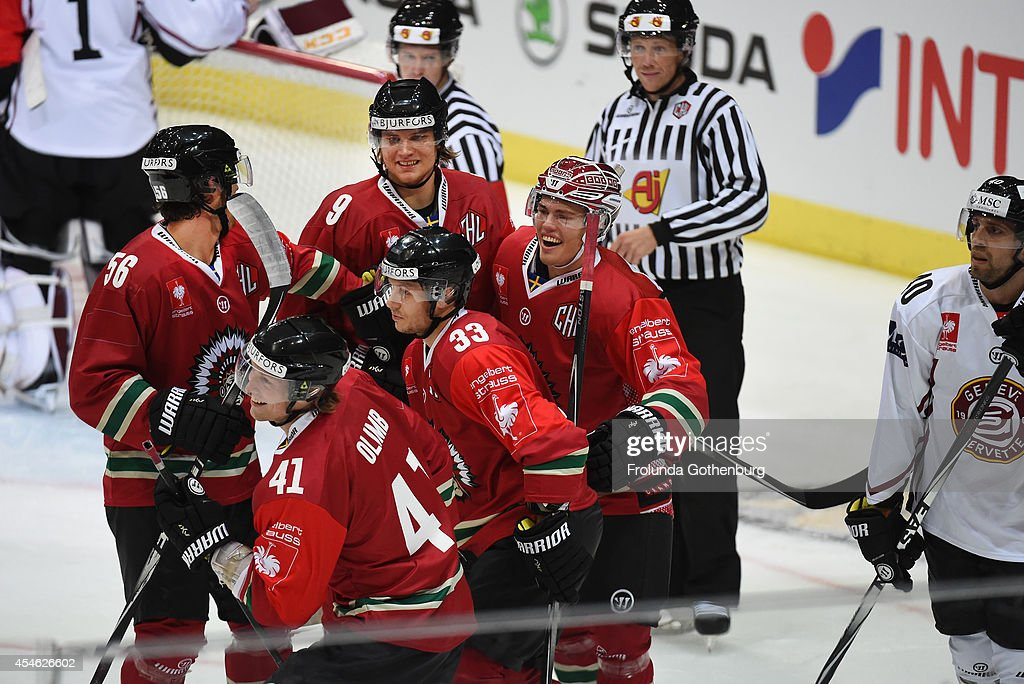 Andreas Johnson (R) of Frolunda celebrates with team-mates after scoring the opening during the Champions Hockey League group stage game between Frolunda Gothenburg and Geneve-Servette at Scandinavium on September 04, 2014 in Gothenburg, Sweden.