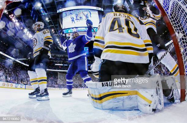 Andreas Johnsson of the Toronto Maple Leafs celebrates a goal by teammate James van Riemsdyk as Tuukka Rask and Brad Marchand of the Boston Bruins...