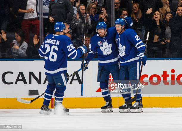Andreas Johnsson of the Toronto Maple Leafs celebrates his goal with teammates Connor Brown and Par Lindholm during the second period against the New...