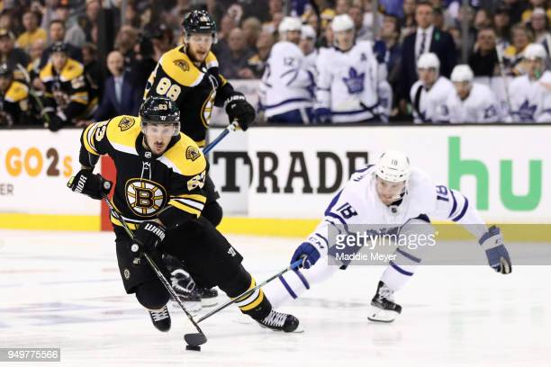 Andreas Johnsson of the Toronto Maple Leafs defends Brad Marchand of the Boston Bruins during the first period of Game Five of the Eastern Conference...