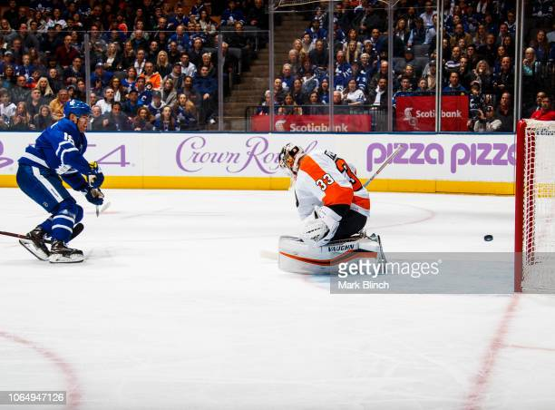 Andreas Johnsson of the Toronto Maple Leafs scores his second goal of the night against Cal Pickard of the Philadelphia Flyers during the first...