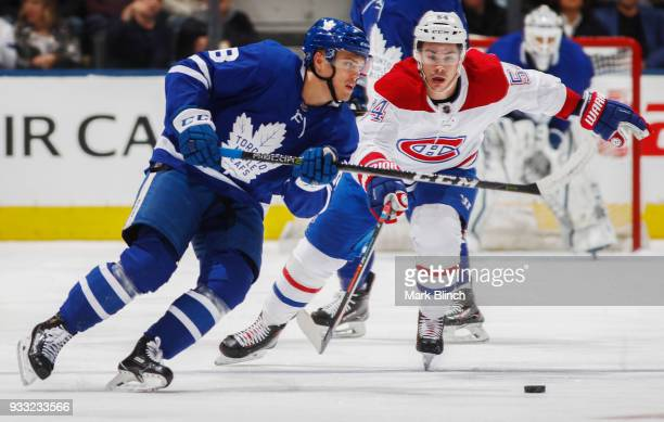 Andreas Johnsson of the Toronto Maple Leafs skates against Charles Hudon of the Montreal Canadiens during the first period at the Air Canada Centre...