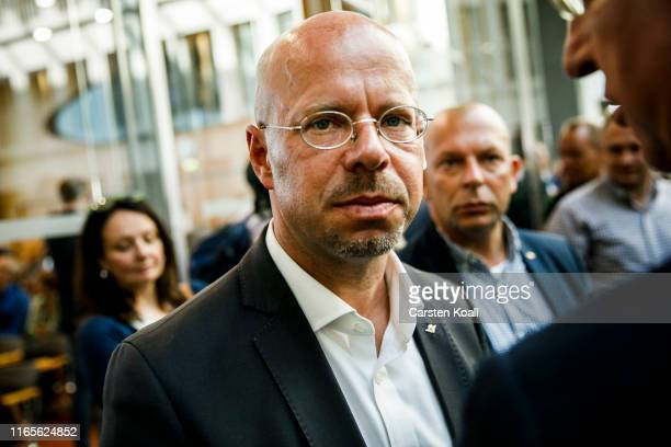 Andreas Kalbitz lead candidate of the rightwing Alternative for Germany political party in elections in Brandenburg state leaves a press conference...