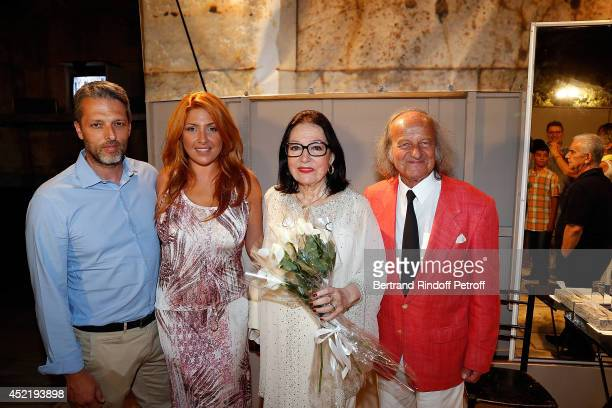 Andreas Kapsalis and his wife Helena Paparizou Nana Mouskouri and her husband Andre Chapelle pose after the 'Nana Mouskouri Birthday Tour' In Herod...
