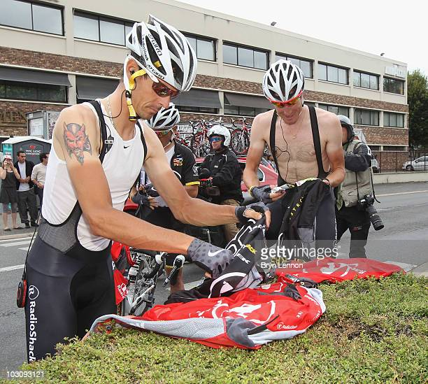Andreas Klöden of team Radioshack changes his kit during the twentieth and final stage of Le Tour de France 2010, from Longjumeau to the...