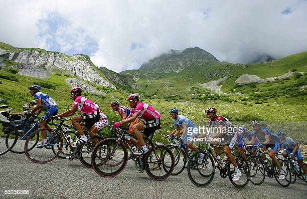 Andreas Kloden of Germany riding for the T-Mobile cycling team in the pink jersey, Jan Ullrich of Germany and Ivan Basso of Italy riding for the CSC...
