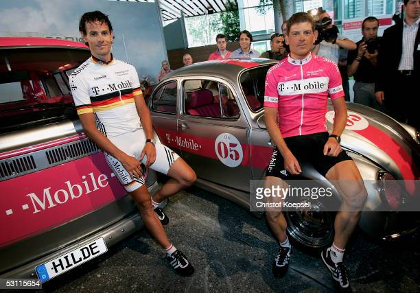 Andreas Kloeden and Jan Ullrich stand in front of an old beetle and bus after the presentation of the T-Mobile Team for the Tour de France 2005 on...