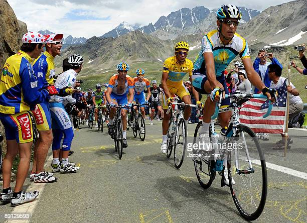 Andreas Kloeden of Germany and team Astana leads his teammate and race leader Alberto Contador of Spain in his yellow jersey up the Col du...