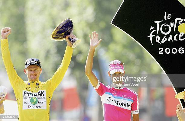 Andreas Kloeden of Germany and T-Mobile celebrates his second place as Floyd Landis of the USA and Phonak celebrates with the yellow jersey as...