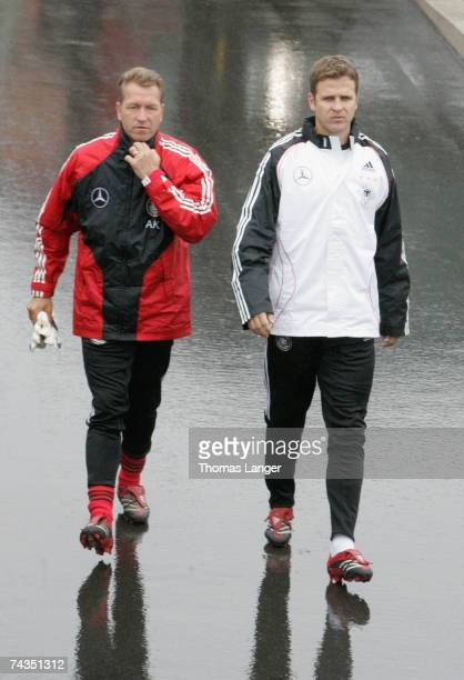 Andreas Koepke and Oliver Bierhoff walk to the venue prior the German National Team training session at the AdidasStadium on May 29 2007 in...