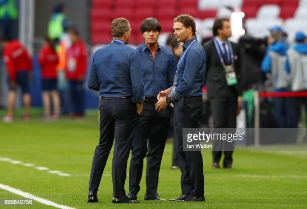 Andreas Koepke goalkeeping coach of Germany Joachim Loew coach of Germany and Thomas Schneider assistant coach of Germany speak prior to the FIFA...