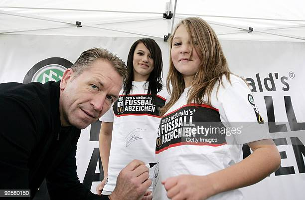 Andreas Koepke signs shirts of football girls during the 2500th DFB Football Badge on October 31 2009 in Vorbach Germany