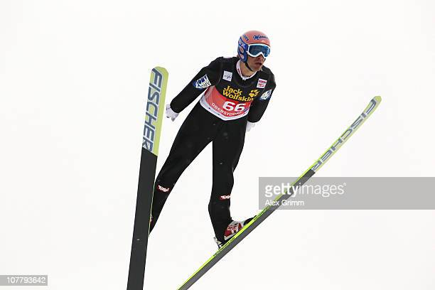 Andreas Kofler of Austria competes during the training round for the FIS Ski Jumping World Cup event at the 59th Four Hills ski jumping tournament at...