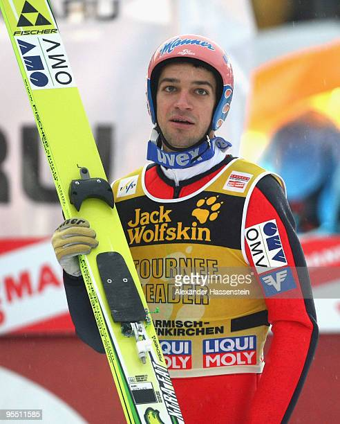 Andreas Kofler of Austria looks on after the qualification round the FIS Ski Jumping World Cup event of the 58th Four Hills ski jumping tournament at...