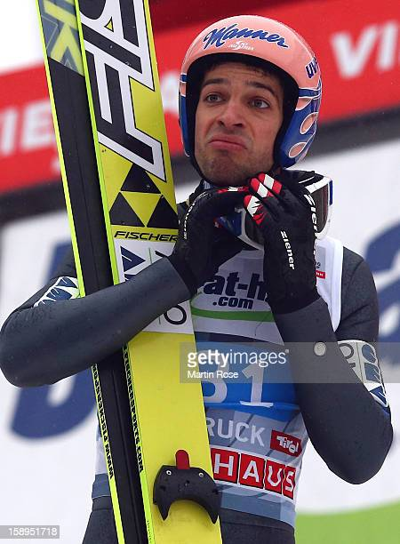 Andreas Kofler of Austria reacts during the final round for the FIS Ski Jumping World Cup event of the 61st Four Hills ski jumping tournament at...