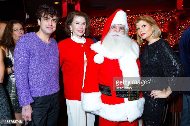 Andreas Kostopoulos, Sara Colleton, Santa Claus and Ivana Lowell attend Anne Hearst McInerney, Jay McInerney And George Farias Host Christmas Cheer...