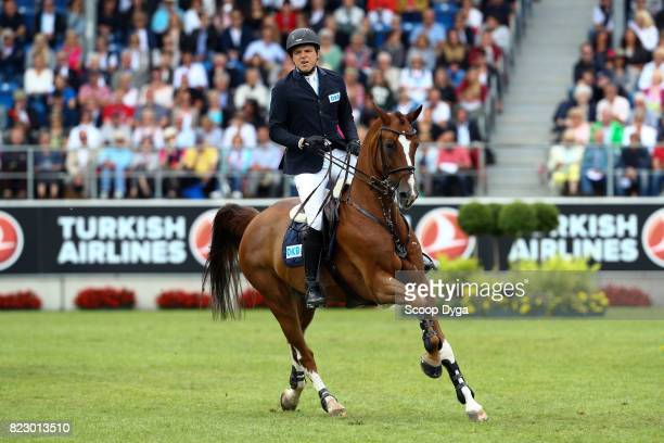 Andreas KREUZER riding CALVILOT during the Rolex Grand Prix part of the Rolex Grand Slam of Show Jumping of the World Equestrian Festival on July 23...